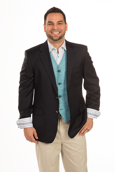 Traditional navy blazer by Carelli worn with aqua blue linen Luciano Visconti vest and Luciano Visconti hidden button down collar contemporary striped shirt, Savane cotton twill pant and Torino belt.